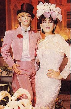 Duran Duran's Nick Rhodes marrying Julie Ann Friedman (of Des Moines, IA) in the early Pink flamingos, pink tux, pink lipstick. Turns out my daughter's librarian knows Julie Ann. Nick Rhodes, John Taylor, Celebrity Wedding Photos, Celebrity Weddings, Simon Le Bon, Duran Duran 80s, Pink Tux, 1980s Wedding, Wedding Vintage