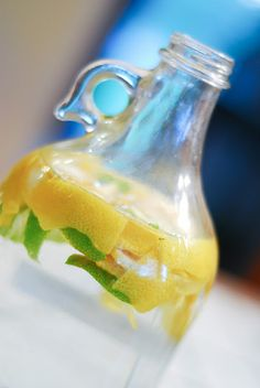 I do this with my vinegar for cleaning- put citrus peel in the bottle and it smells great- rather than like you cleaned the house with salad dressing. And I have am happy to give the small girl a spray bottle of her own to clean with, it is totally safe and cheap.