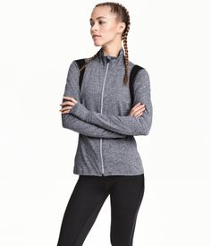Dark gray melange. Fitted running jacket in fast-drying functional fabric. Stand-up collar, reflective zip at front, and side pockets with concealed zip.