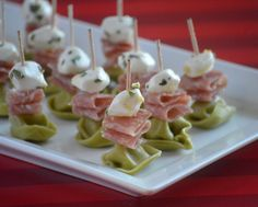 Mouth watering fresh mozzarella pearls are marinated in olive oil and herbs then stacked with spicy salami and tender cheese filled tortellini for a simple yet festive one bite appetizer.