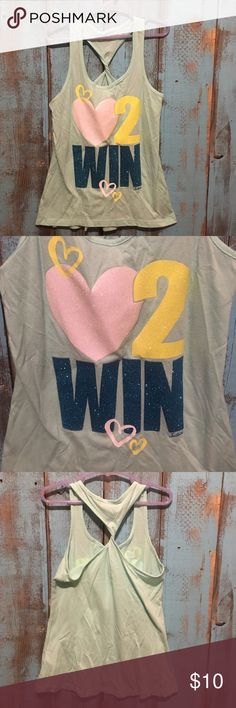 Justice tank top. Little girls size 8 Excellent condition! Little girls tank top by Justice! Says love to win on the front in glittery letters! Little girls size 8 Justice Shirts & Tops Tank Tops
