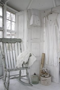An antiqued rocking chair against a white washed room makes this the focal point.
