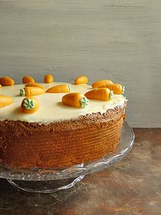 Swiss Carrot Cake _ When I moved to Switzerland this cake became my absolute favorite Swiss dessert. Traditionally there is a shiny sugar glaze on top & Marzipan carrots. However it is also perfect with a cream cheese frosting!