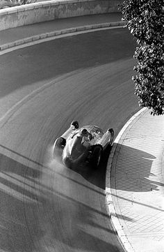 Juan Manuel Fangio drifts his Ferrari through Mirabeau 1956