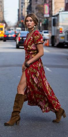 8 Times Celebrities Got Groovy with the '70s Trend | InStyle.com Hailey Baldwin hit the streets of N.Y.C. in a floral boho dress that she accessorized with silver chandelier earrings, layers of necklaces, and knee-high suede brown boots.