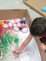 balloons of ice - rolling in paint childminding-ideas-for-4-8-yr-olds