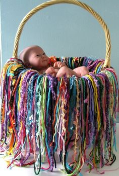 A wonderful creation, this blanket will be perfect for pictures on so many occasions. So many colors and textires combined together! It is very versatile and very easy to manage. The fringe is securely attached to the central square to keep the little model warm and comfy.