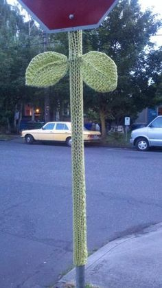 Yarn bomb; normally not a huge fan, but I love this one; will do right in front of my apt. if I can find some green scraps.