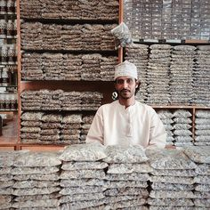 A vendor surrounded on all sides by frankincense at his shop in the Al Husn Souq in Salalah, Oman. Feb 2015 photo by Lindsay Mackenzie