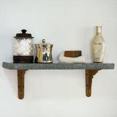 polished chiseled edge granite shelf with arrow scrollwork brackets