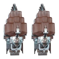 Pair American Art Deco Sculptural Aluminum & Pink Glass Sconces