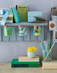 Jelly jars attached to a shelf provide extra storage space and a splash of color when filled with bright craft and office supplies.