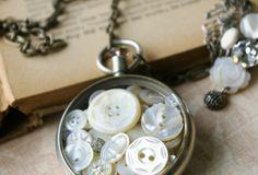 Vintage Buttons in a Tim Holtz Pocket Watch.