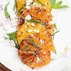 Try a new way of eating citrus fruit -- by broiling them! Top broiled slices of oranges and grapefruit with feta cheese and mint, then enjoy!