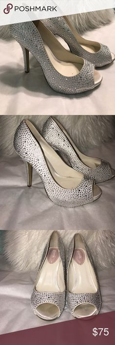 White satin rhinestone heels EUC. Tried on but never worn outside. There are 4 tiny stones missing (shown in photos) but it is not noticeable when wearing.  Would make a beautiful pair of wedding shoes! Paradox London Pink Shoes Heels