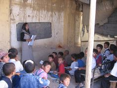 Children in a classroom without walls at the Abdul Hali Mazare School in Mazar I Sharif, Afghanistan