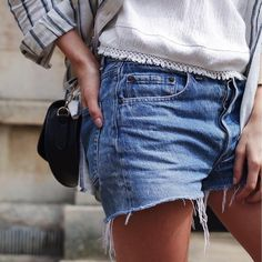 Striped Shirt Layered Over Cheesecloth Tassel Trim Top & Levis Vintage Denim Shorts | Blogger Style