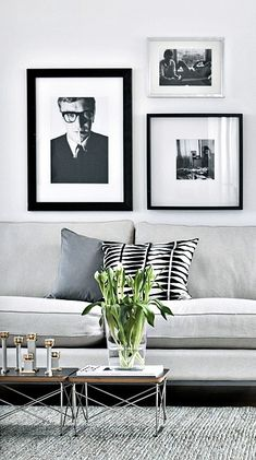 Loving the Black and White portraits.  Via Nordic Days | Eames-friendly Apartment www.nordicdays.nl