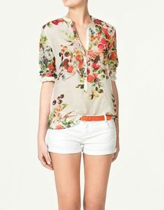Cute floral top with shorts and pink belt.  Pretty summer outfit.