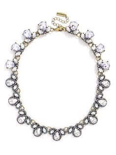 Teardrop gem clusters compose this gem-encrusted collar in a cool shade of lilac for a soft, delicate touch.
