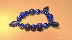 Ausgefallenes Armband bestehend aus 16 handgefertigten Perlen und 5 Kunststoffperlen.    Polymer Clay ist eine ofenhärtende Modelliermasse, die es in