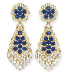 A PAIR OF SAPPHIRE AND DIAMOND EAR PENDANTS, BY VAN CLEEF & ARPELS  Each suspending a circular-cut sapphire and diamond lozenge-shaped pendant with marquise-cut diamond fringe, to the circular-cut sapphire and diamond surmount of similar design, mounted in gold