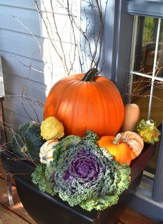 Add a couple of twigs, and a flowering cabbage and you've got yourself a beautiful way of decorating a  fall porch without the fuss. Description from todayscreativeblog.net. I searched for this on bing.com/images