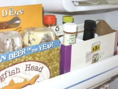 Organize door shelves with six-pack beer boxes.