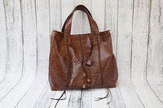 You can buy this really cool Large Brown Leather Tote by PointShootCreate on Etsy