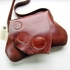 The latest rage among Borrowers...Each bag is unique owing to the natural variations in colour and texture across the hide, shown here in buttery soft, rich chestnut brown. I call it Polished Nut. Complete with Big button detailing on the front. Antiqued magnetic closure. Shoulder length handle at the perfect length for either slinging on your shoulder or swinging jauntily. Large unlined interior for all your paraphernalia... including an exterior large pocket for keys, glasse...