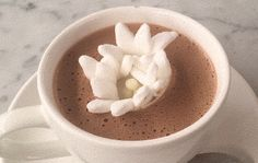 Dominique Ansel – creator of the Cronut and cookie shots – has just made a true hot choc masterpiece.  Dominique's Blossoming Hot Chocolate is topped with a marshmallow flower held closed by a small, thin ring of white chocolate.