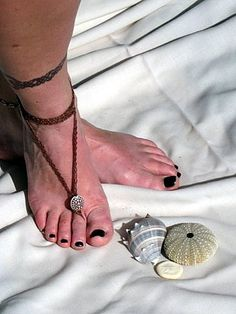 feet are often overlooked where jewelry is concerned. However, nothing is as comfortable as bare feet, so once you try a barefoot sandal, or toe thong, and complete your look you will never want to be