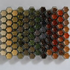 Magnetic hexagonal spice jars. Too small, but a fantastic idea to free up cupboards. @Nicole George