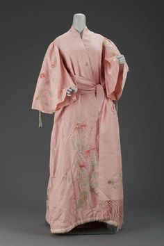 Women's dressing gown by Iida Takashimaya, ca. 1900 Japan (Kyoto, for the Western market), the Museum of Fine Arts, Boston  Pink silk taffeta dressing gown in kimono style with embroidered naturalistic chrysanthemums and butterflies in polychrome silks. Silk plain weave lining, padded hem and pleat in back of robe. Full sleeves gathered at shoulders and trimmed with braided silk cord and tassles. Matching sash of pink silk taffeta with double-sided embroidery of chrysanthemums in green ...