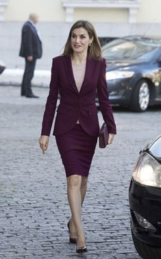 Purple suit with light purple blouse