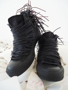 dastylethatrocks: Black Converse sneakers painted and decorated with faux leather, rubber cords, handmade rubber meshwork at the back with mat end, and added shoe-laces.