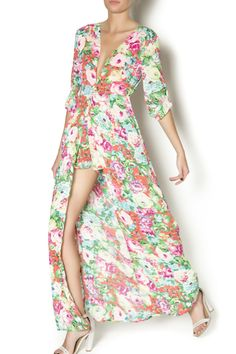 250d344e96d Floral printed romper with a maxi skirt overlay. This romper features lined  shorts