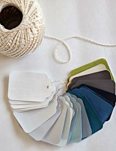 paint swatches - paint on tags, string together, handwrite names and rooms on back..