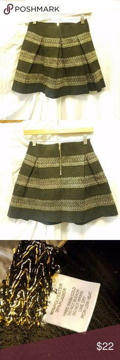 Final GINGER G elastic  A-line skirt, size Large Black w/contrasting gold & silver stripes 80/20 polyester/rubber skirt Back exposed zipper  Excellent condition GINGER G Skirts Circle & Skater