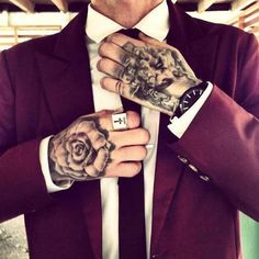tattooed men in suits