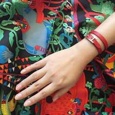 When it gets chilly a pop of red adds warmth to your outfit and the heart. Double tour leather bracelet and 90 silk scarf by Hermes.  #whatiwore #instagood #chic #whatiworetoday #style #hermes #leatherbracelet #scarf #bracelet by ambernmusk