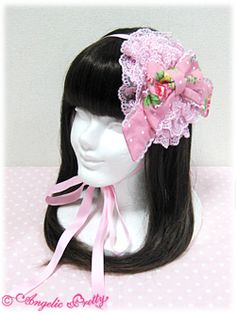 I love headdresses like these, Even though they do look like you glued a doily and some ribbon on a headband ;)