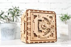 Buy now the UGEARS Safe Model from kooqie and build your own personal lock combination. Wooden Puzzles, Build Your Own, 3 D, Two By Two, Decorative Boxes, Eco Green, Interior Plants, Creative, Minimal