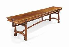 AN ART NOUVEAU MAHOGANY AND PINE REFECTORY TABLE