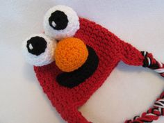 A personal favorite from my Etsy shop https://www.etsy.com/listing/475163421/baby-elmo-hat-sesame-street