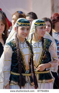 TBILISI, GEORGIA - OCTOBER 9: Unidentified Participants of Georgian Folk Autumn Festival - Tbilisoba, in azerbaijan traditional costume dancing Asma Kasma dance, October 9, 2011 in Tbilisi, Georgia. by Anna Bogush, via ShutterStock