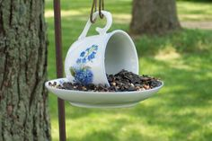 Darling little birdfeeder, made from a cup and saucer.  No instructions here, but it seems like all it would take would be some strong glue (superglue?) and hooks and a chain to hang it with.  The hardest part would be making sure it hangs evenly, but I could figure that out...