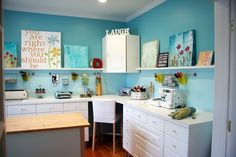 I like the two tone walls with all the shining white cabinets. Very soothing.