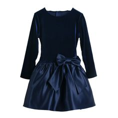 A beautiful special occasion dress for your little girl by Sweet Kids. This navy dress is made of a velvet top and has long  bell velvet sleeves and a satin skirt with a big satin bow at the waistline. She will look beautiful in this dress for Christmas p