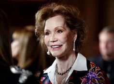 Mary Tyler Moore, who played TV's first sexy housewife and then a single, career woman who could turn the world on with her smile and toss her hat in the air like no other, died on Wednesday. She was 80.